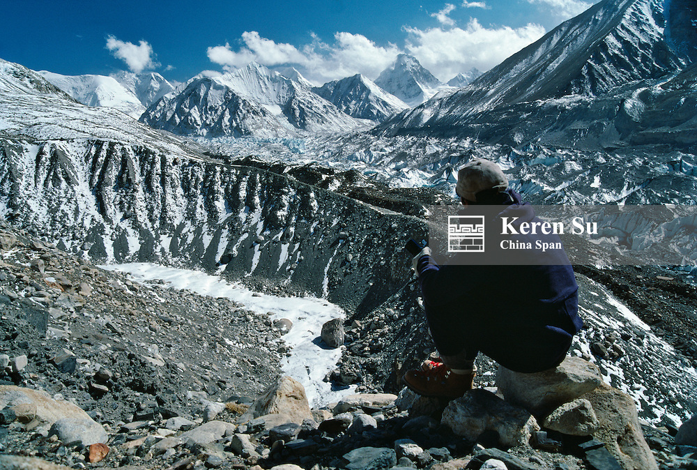 Hiker in Rongbuk Glacier enroute to Mt. Everest, Tibet, China