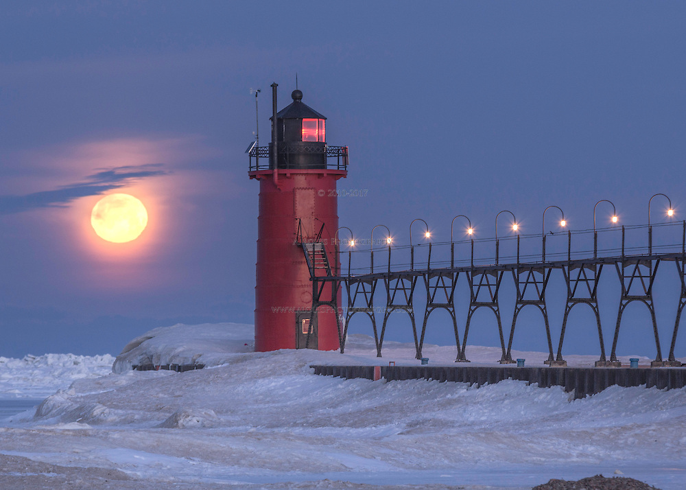 The full moon getting close to set on a frozen Lake Michigan at South haven