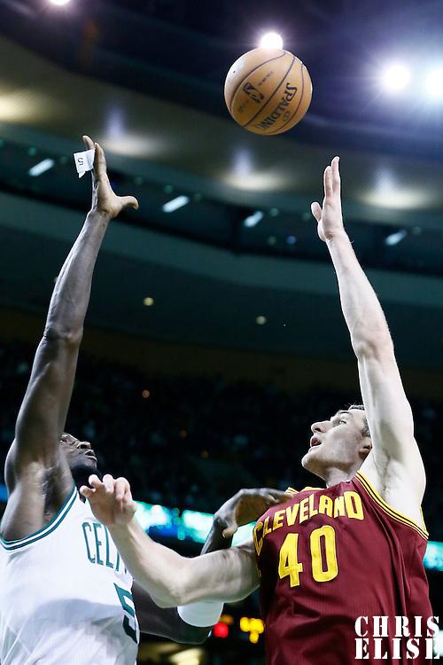 19 December 2012: Cleveland Cavaliers center Tyler Zeller (40) goes for the skyhook over Boston Celtics power forward Kevin Garnett (5) during the Boston Celtics 103-91 victory over the Cleveland Cavaliers at the TD Garden, Boston, Massachusetts, USA.