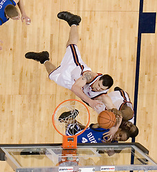 Virginia's Jason Cain (33) and Will Harris (1) fight for a rebound with Duke's Lance Thomas (42).  The University of Virginia Cavaliers beat the #8 ranked Duke University Blue Devils 68-66 in overtime at the John Paul Jones Arena in Charlottesville, VA on February 1, 2007...