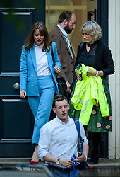 © Licensed to London News Pictures. 09/06/2017. London, UK. NICK TIMOTHY (Top centre) and FIONA HILL (left), advisors to leader of the conservative party Theresa May, are seen leaving Conservative Party headquarters on the morning of the general election results. Photo credit: Ben Cawthra/LNP
