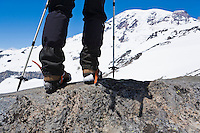 Legs and feet of a hiker on Mt. Rainier.