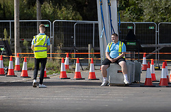 © Licensed to London News Pictures. 19/09/2020. Chessington, UK. Test & Trace staff staff wait for people to arrive at a Covid-19 testing centre set up in the car park of Chessington World of Adventures south west of London. The Government have faced criticism over delays in getting tested for the COVID-19 strain of coronavirus. . Photo credit: Peter Macdiarmid/LNP
