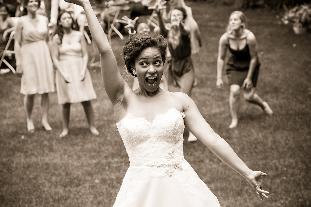 A bride tosses her bouquet in Brattleboro, VT.