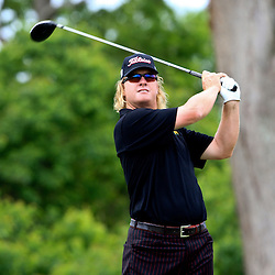 2009 April 26: Charlie Hoffman of Las Vegas, NV tee's off on the eighth hole during the final round of the Zurich Classic of New Orleans PGA Tour golf tournament played at TPC Louisiana in Avondale, Louisiana.