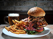 Cowboy Burger - 10oz. sirloin burger with bacon, cheddar, crispy onions, jalapeños and barbecue sauce served at 516 American Kitchen & Bar in Syosset, N.Y.