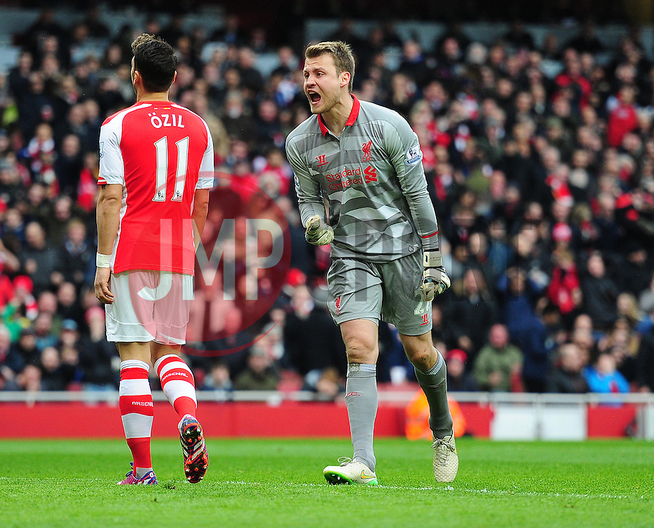 Simon Mignolet  of Liverpool shouts in frustration at his defence.  - Photo mandatory by-line: Alex James/JMP - Mobile: 07966 386802 - 04/04/2015 - SPORT - Football - London - Emirates Stadium - Arsenal v Liverpool - Barclays Premier League
