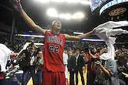 Ole Miss' Marshall Henderson (22) celebrates beating Florida in the SEC championship game at Bridgestone Arena in Nashville, Tenn. on Sunday, March 17, 2013. Ole Miss won 66-63.