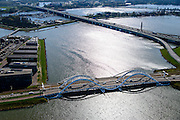 Nederland, Noord-Holland, Amsterdam, 20-04-2015; IJburg,  Buiten-IJ met IJburglaan en Enneus Heermabrug. Links Steigereiland, rechts Zeeburgerbrug (RIng A10)<br /> Entrance to IJburg, the new urban development district of Amsterdam, along the central road, the Enneus Heerma Bridge.<br /> luchtfoto (toeslag op standard tarieven);<br /> aerial photo (additional fee required);<br /> copyright foto/photo Siebe Swart