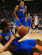 Feb. 17, 2011; Phoenix, AZ, USA; Dallas Mavericks forward Shawn Marion (0) reacts as teammate guard Rodrigue Beaubois (3) fights for a loose ball against the Phoenix Suns at the US Airways Center. Mandatory Credit: Jennifer Stewart-US PRESSWIRE