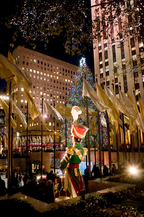 The famous, annual Christmas decorations and large tree adorn Rockafeller Center, New York.
