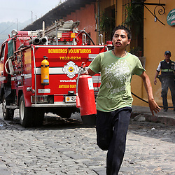 Young waiter races to refil extinguisher during restaurant blaze following gas cylinder explosion in Antigua, Guatemala