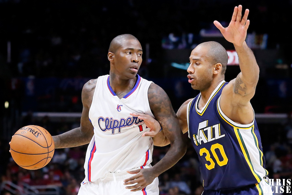 17 October 2014: Utah Jazz guard Dahntay Jones (30) defends on Los Angeles Clippers guard Jamal Crawford (11) during the Los Angeles Clippers 101-97 victory over the Utah Jazz, in a preseason game, at the Staples Center, Los Angeles, California, USA.