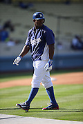 LOS ANGELES, CA - AUGUST 20:  Yasiel Puig #66 of the Los Angeles Dodgers looks on during batting practice before the game against the San Diego Padres at Dodger Stadium on Wednesday, August 20, 2014 in Los Angeles, California. The Padres won the game 4-1. (Photo by Paul Spinelli/MLB Photos via Getty Images) *** Local Caption *** Yasiel Puig