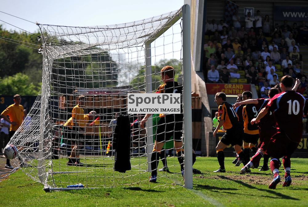 John Boyack (maroon, 6, hidden) score the second goal for Shotts..Auchinleck Talbot v Shotts Bon Accord, Emirates Junior Cup Final,  Sunday 27th May 2012..ALEX TODD | STOCKPIX.EU