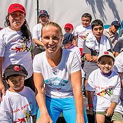 August 23, 2016, New Haven, Connecticut: <br /> Svetlana Kuznetsova of Russia poses with kids during a Latino Day clinic at the AETNA Fit Zone during Day 5 of the 2016 Connecticut Open at the Yale University Tennis Center on Tuesday, August  23, 2016 in New Haven, Connecticut. <br /> (Photo by Billie Weiss/Connecticut Open)