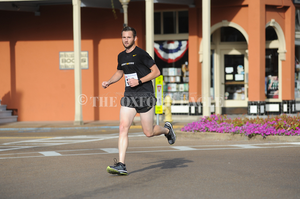 Todd Griffith wins the Oxford Lafayette Humane Society's annual Stars and Stripes 5K in Oxford, Miss. on Monday, July 4, 2016.