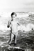 young boy posing standing in the sea 1950