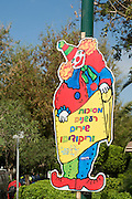 Israel, Tel Aviv, Purim Celebration a clown sign