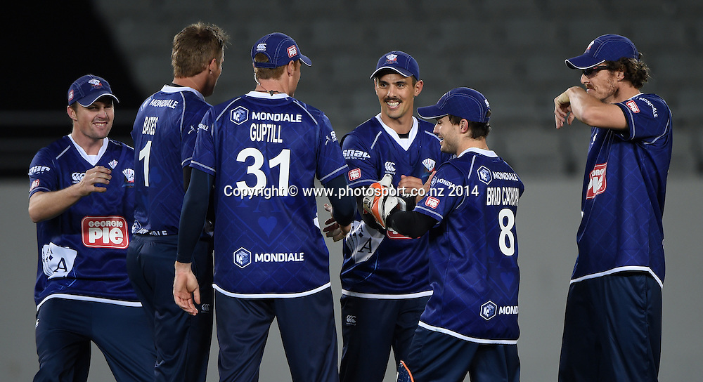 Auckland players celebrate a wicket during the Georgie Pie Super Smash Twenty20 cricket match between the Auckland Aces and Wellington Firebirds at Eden Park, Auckland on Friday 14 November 2014. Photo: Andrew Cornaga / www.Photosport.co.nz
