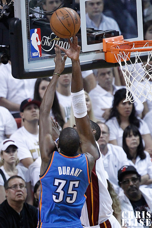 17 June 2012: Miami Heat shooting guard Dwyane Wade (3) blocks Oklahoma City Thunder small forward Kevin Durant (35) during the Miami Heat 91-85 victory over the Oklahoma City Thunder, in Game 3 of the 2012 NBA Finals, at the AmericanAirlinesArena, Miami, Florida, USA.