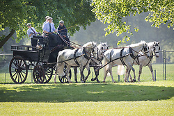 © Licensed to London News Pictures. 09/05/2018. Windsor, UK. A carriage and horses are exercised on the morning of the first day of the 75th Royal Windsor Horse Show . The five day event takes place in the grounds of Windsor Castle. The Queen and the Duke of Edinburgh usually attend. Photo credit: Peter Macdiarmid/LNP