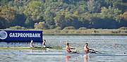 Varese,  ITALY. 2012 FISA European Championships, Lake Varese Regatta Course. ..Men's Pair, Repechage. GBR M2- Bow. Kieran EMERY and Matt TARRANT, watching the second placed pair from Poland [POL M2-] as  both crews  go through to Sundays Final...09:51:14  Saturday  15/09/2012 .....[Mandatory Credit Peter Spurrier:  Intersport Images]  ..2012 European Rowing Championships Rowing, European,  2012 010828.jpg.....