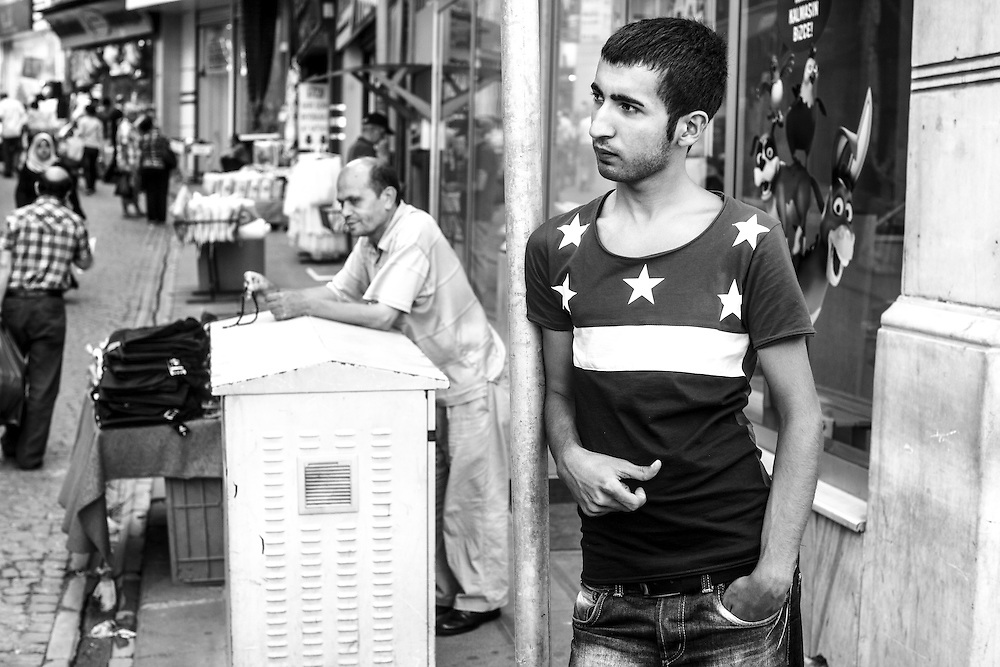 A young man waits in one of the streets that surround the Grand Bazaar in Istanbul.