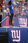 Actress and Broadway musical singer Mandy Gonzalez sings the National Anthem before the New York Giants NFL week 3 regular season football game against the Houston Texans on Sunday, Sept. 21, 2014 in East Rutherford, N.J. The Giants won the game 30-17. ©Paul Anthony Spinelli