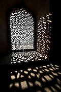 Sunlight filtering through the intricate latticework of a window in Humayun's Tomb.<br /> (Photo by Matt Considine - Images of Asia Collection)