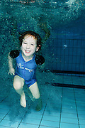 Girl of 4 swims underwater