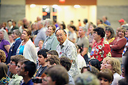 Synergy - Bridging. After WWII age group speaker, those in that generation stand while singing.© 2012 Nancy Pierce/UUA