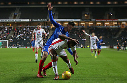 Andrew Hughes of Peterborough United fouls Ethan Ebanks-Landell of Milton Keynes Dons - Mandatory by-line: Joe Dent/JMP - 30/12/2017 - FOOTBALL - Stadium MK - Milton Keynes, England - Milton Keynes Dons v Peterborough United - Sky Bet League One