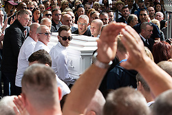 © Licensed to London News Pictures . Salford , UK . File picture of JOHN KINSELLA (top centre with cropped grey hair and glasses, behind coffin) carrying Paul Massey's coffin at Paul Massey's funeral , in Salford , on 28th May 2015. Police have arrested several men in connection with the murders of both Kinsella and Massey. Photo credit : Joel Goodman/LNP