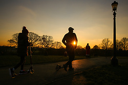 © Licensed to London News Pictures. 20/01/2019. London, UK. People walking on Primrose Hill during a golden winter sunset after a sunny day in the capital. Photo credit: Dinendra Haria/LNP