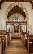 Village parish church Parham, Suffolk, England, UK view of chancel arch rood screen and  east window