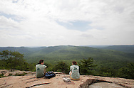 Bear Mountain, New York - Two volunteers enjoy the view after hiking to the top of Bear Mountain on a newly rebuilt section of the Appalachian Trail during National Trails Day at Bear Mountain on June 5, 2010. A ceremony and hike celebrated the reconstruction of this original section of the Appalachian Trail.