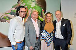 Left to right, MIKE DARGAS, BORIS BECKER his wife LILLY and JEAN DAVID MALAT at a private view of woks by German artist Mike Dargas held at the Opera Gallery, 134 New Bond Street, London on 5th July 2016.