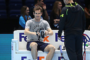 Andy Murray smiles in his warm up before the ATP World Tour Finals at the O2 Arena, London, United Kingdom on 20 November 2015. Photo by Phil Duncan.