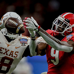 Jan 1, 2019; New Orleans, LA, USA; Texas Longhorns defensive back Davante Davis (18) breaks up a pass to Georgia Bulldogs wide receiver Jeremiah Holloman (9) during the second quarter in the 2019 Sugar Bowl at Mercedes-Benz Superdome. Mandatory Credit: Derick E. Hingle-USA TODAY Sports