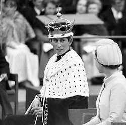 The Prince of Wales, wearing 20th century gold coronet and ermine mantle, part of the insignia of his principality and Earldom of chester, after his investiture at Caernarfon Castle.