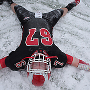 James Keneally, New Canaan, celebrates victory by making an angel in the snow after the New Canaan Rams Vs Darien Blue Wave, CIAC Football Championship Class L Final at Boyle Stadium, Stamford. The New Canaan Rams won the match in snowy conditions 44-12. Stamford,  Connecticut, USA. 14th December 2013. Photo Tim Clayton