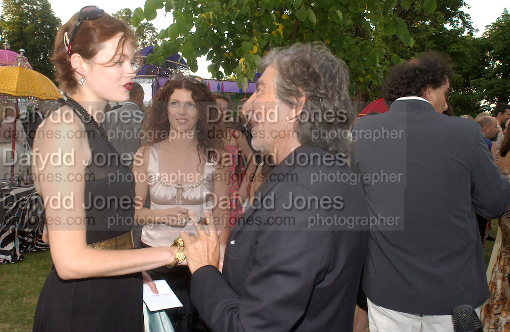 Jasmine guinness and Robert Cavalli, The  Summer party, hosted by the Serpentine Gallery and Robert Cavalli, 16 June 2004. 16 June 2004. SUPPLIED FOR ONE-TIME USE ONLY> DO NOT ARCHIVE. © Copyright Photograph by Dafydd Jones 66 Stockwell Park Rd. London SW9 0DA Tel 020 7733 0108 www.dafjones.com