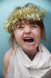 Portrait of a young girl with tinsel on her head,