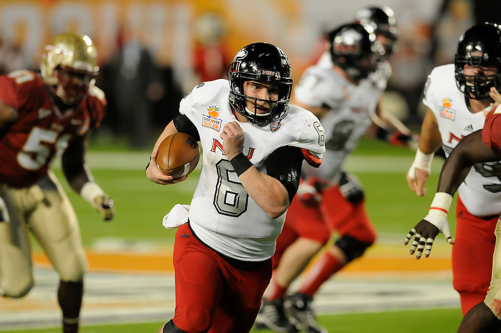 January 1, 2013: Jordan Lynch #6 of Northern Illinois rushes upfield during the NCAA football game between the Northern Illinois Huskies and the Florida State Seminoles at the 2013 Orange Bowl in Miami Gardens, Florida. The Seminoles defeated the Huskies 31-10.