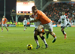 BLACKPOOL, ENGLAND - Tuesday, January 25, 2011: Manchester United's Rafael Da Silva brings down Blackpool's Luke Varney but no penalty is given during the Premiership match at Bloomfield Road. (Photo by David Rawcliffe/Propaganda)