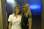 CELINE HUBER AND PAULINA ZAJAC, Swiss Smile Clinic Christmas Drinks. Brook St. London. 5 December 2007. -DO NOT ARCHIVE-© Copyright Photograph by Dafydd Jones. 248 Clapham Rd. London SW9 0PZ. Tel 0207 820 0771. www.dafjones.com.