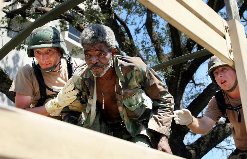 Russell Wharton is evacuated by the Oregon National Guard's 1186th Military Police. Oregon National Guard troops work in New Orleans after the wrath of Hurricane Katrina. Photographed September 8, 2005. (Thomas Patterson / Statesman Journal)