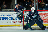 KELOWNA, CANADA - JANUARY 5: Austin Strand #2 clears the puck from behind the net of Liam Hughes #30 of the Seattle Thunderbirds against the Kelowna Rockets on January 5, 2017 at Prospera Place in Kelowna, British Columbia, Canada.  (Photo by Marissa Baecker/Shoot the Breeze)  *** Local Caption ***
