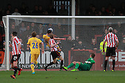Ross Hannah scores and celebrates his goal during the Vanarama National League match between Cheltenham Town and Chester City at Whaddon Road, Cheltenham, England on 5 December 2015. Photo by Antony Thompson.